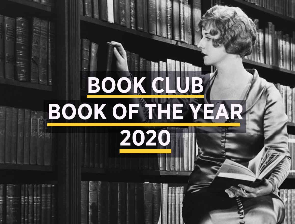 woman selecting book from self to illustrate book club book of the year article